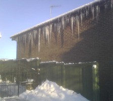 Icicles on side of house next door